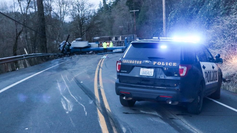 1 dead, two injured after logging truck rolls over, hits car