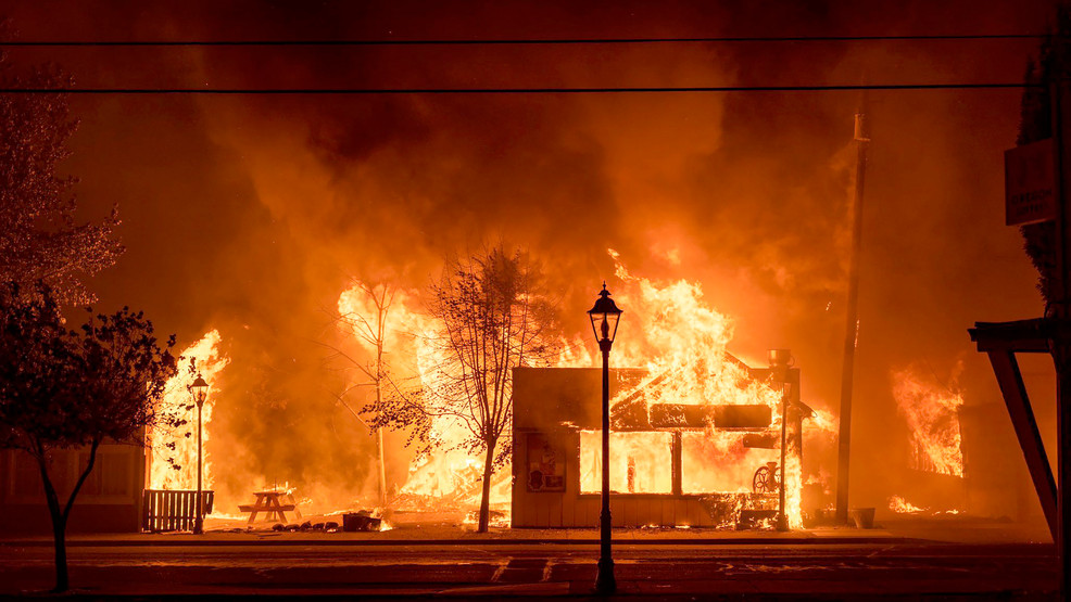 Buildings are engulfed in flames as a wildfire ravages the central Oregon town of Talent near Medford late Tuesday, Sept. 8, 2020. (Kevin Jantzer via AP)