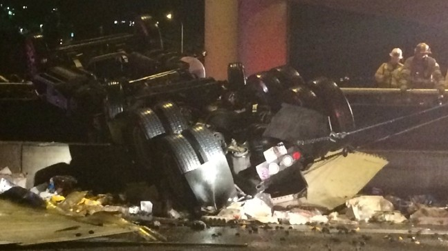 Semi-truck plunges off I-405 overpass onto freeway below
