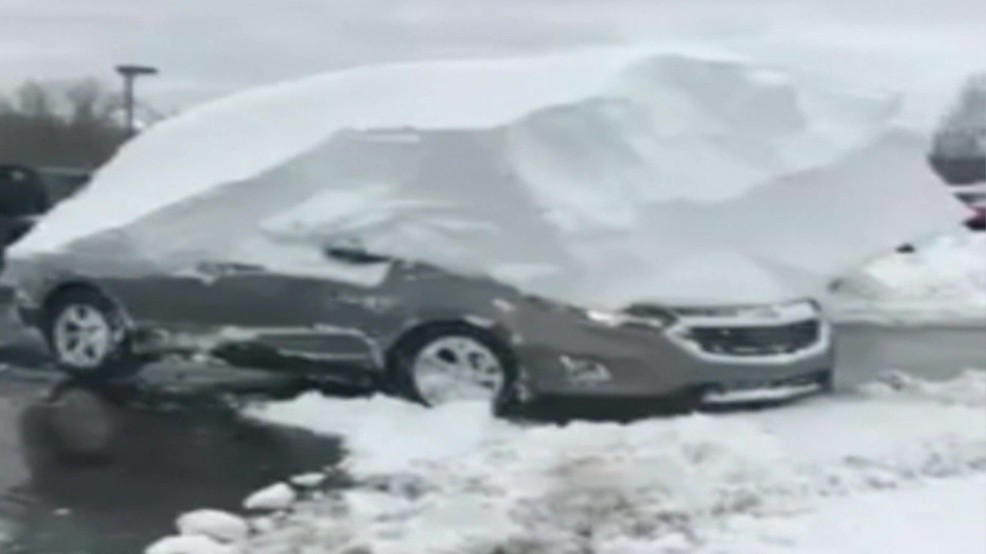 Watch: Wisconsin car dealership frees cars buried under feet