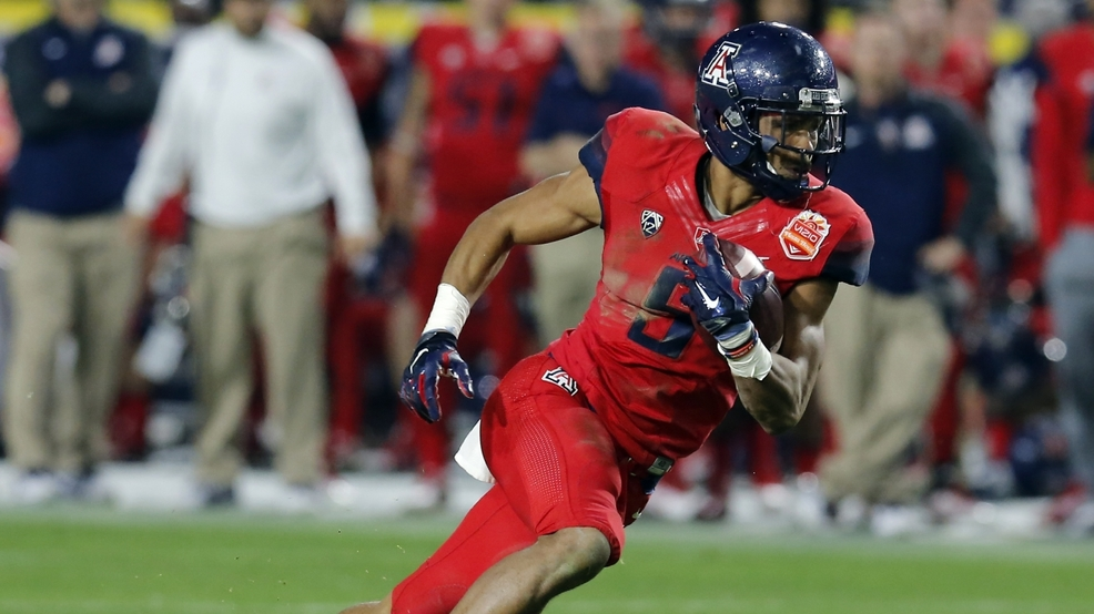 117e45d219 FILE - In this Dec. 31, 2014, file photo, Arizona running back Trey Griffey  (5) carries the ball in the first half on Fiesta Bowl NCAA college football  game ...