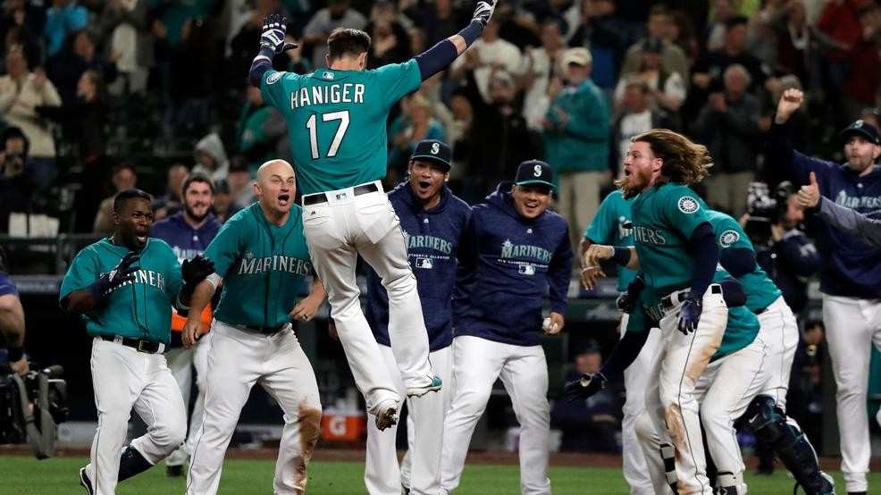 83fbe35beff Seattle Mariners  Mitch Haniger (17) leaps onto home plate after he hit a  walk-off home run against the Tampa Bay Rays during the 13th inning of a  baseball ...