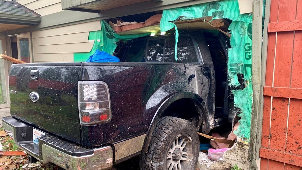 Truck plows into Spanaway home, crashes into bunk bed as