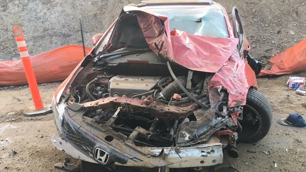 2 severely injured as car crashes down embankment in