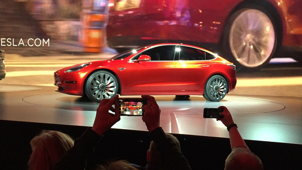 File In This March 31 2016 Photo Tesla Motors Unveils The New Lower Priced Model 3 Sedan At Design Studio Hawthorne Calif