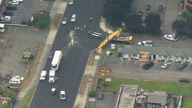 Crane smashes into power pole in truck crash in Fife | KOMO