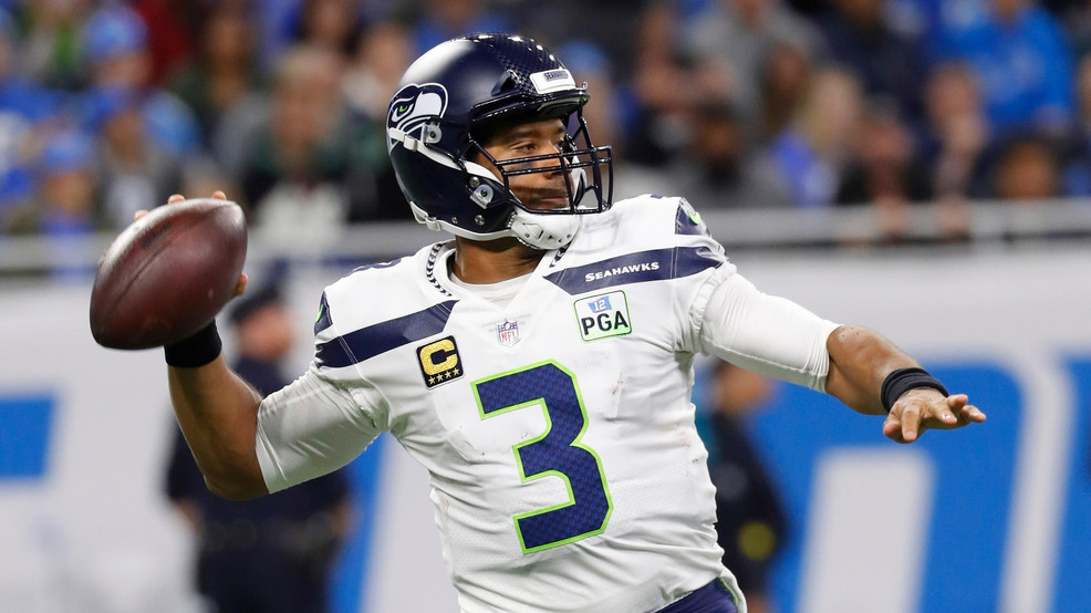 c09de7931200 Seattle Seahawks quarterback Russell Wilson prepares to throw during the  first half of an NFL football game against the Detroit Lions, Sunday, Oct.  28, ...